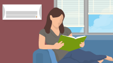 Woman Reading Book in Air-Conditioned Home